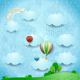 Surreal landscape with rain and hot air balloons Royalty Free Stock Image