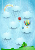 Surreal landscape with rain and hot air balloons Royalty Free Stock Photography