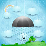 Surreal landscape with umbrella and rain Royalty Free Stock Photos