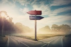 Free Surreal Landscape With A Split Road And Signpost Arrows Showing Two Different Courses, Left And Right Direction To Choose. Road Stock Image - 167422571