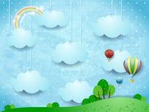 Surreal landschap met het hangen van wolken en hete luchtballons Stock Afbeelding