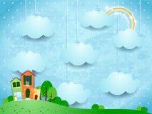 Surreal landschap met het hangen van wolken en huizen Royalty-vrije Stock Foto