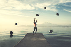 Surreal moment, woman tries to take the black balloons that rain from the sky. Surreal moment, woman tryng to take the black balloons that rain from the sky Royalty Free Stock Photo
