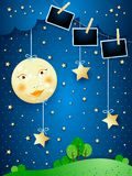 Surreal nacht met volle maan, hangende sterren en fotokaders vector illustratie