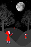 Surreal night. With little red riding hoods looking at the moon Royalty Free Stock Image
