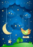 Surreal night with moon, swing and bird Stock Photography