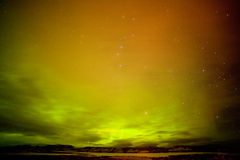 Surreal Northern Lights with clouds and stars sky Royalty Free Stock Image
