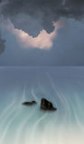 Surreal ocean and clouds Stock Photography