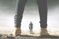 Surreal meeting between a giant and a small woman royalty free stock photography