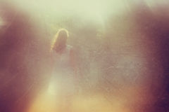 Surreal photo of young woman standing in forest. i Royalty Free Stock Photography