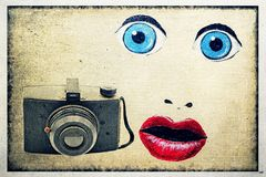 Antique 35mm Film Camera with Painted Eyes, Nose and Lips. Surreal photograph of an antique camera with painted blue eyes, nose and red lips. The face looks a stock photos