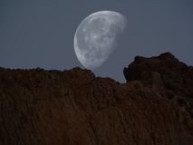Surreal Planet. Moon over Mountain Peak Stock Photos