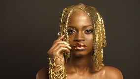 Surreal Portrait of Glossy African American Woman with Bright Golden Makeup. Bronze Bodypaint.  stock video