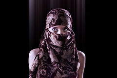 Surreal portrait of a mysterious oriental style woman stock photography