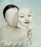 Surreal portrait. Of a woman faceless with her face mask Royalty Free Stock Image