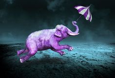 Surreal Purple Violet Flying Elephant. Abstract nature concept of a surreal flying elephant that is the color purple or violet. The wildlife animal uses an Stock Image