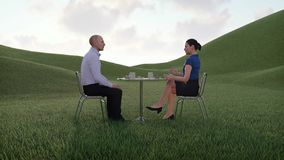 Businesspeople meet at lunch break in countryside. Surreal scene with two formally dressed businesspeople - man and woman sitting at coffee table and talking stock video