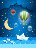 Surreal seascape with hot air balloons and paper boat Stock Photography