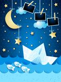 Surreal seascape with paper boat and photo frames, by night. Vector illustration eps10 royalty free illustration