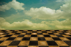 Surreal setting. /background with old worn tiles and cloudscape Stock Image
