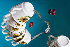 Surreal still life with a flying set of porcelain cups Royalty Free Stock Photography