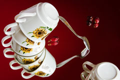Surreal still life with a flying set of porcelain cups Royalty Free Stock Photo
