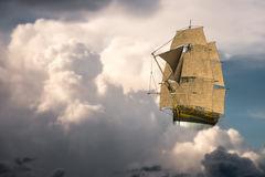 Surreal Tall Sailing Ship, Clouds. Surreal tall sailing ship as it sails and floats in an ocean of clouds in the sky Stock Photography