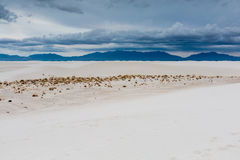 Surreal White Sands of New Mexico with Mountains in the Distance Royalty Free Stock Images