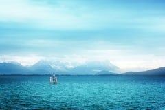 Surreale Ansicht von Bodensee mit den Alpen Stockbilder