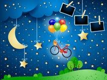 Surreale Nacht mit Fahrrad, hängendem Mond und Fotorahmen stockbilder