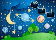 Surrealer Himmel mit Planeten, hängendem Mond und Fotorahmen lizenzfreie stockfotos