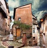Surreales Haus und stürmischer Himmel Stockfotos