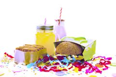 Surrealism Festive composition drinks snacks holiday hamburger cookie tinsel confetti gift box cocktail saturated colors. Children's holiday birthday stock photos
