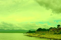 Surrealism vivid seascape coastline. Unity with nature Royalty Free Stock Image