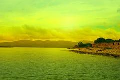 Surrealism vivid seascape coastline. Unity with nature Royalty Free Stock Images