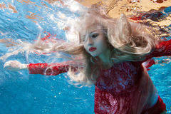 Surrealism is a woman underwater. Stock Image