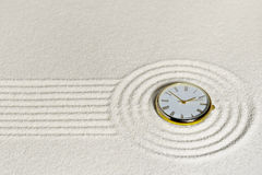 Surrealistic composition with watch on sand Stock Photography