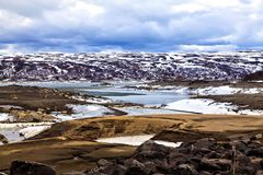 Surrealistic landscape: mountains, lake and land in Scandinavia Stock Photo