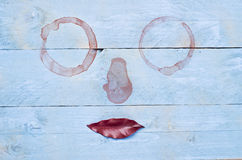 Surrealistic lips funny facial image on wooden blue background Stock Photos