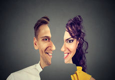 Surrealistic portrait front with cut out profile of a happy young man and woman Royalty Free Stock Photo