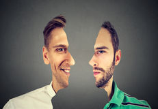 Surrealistic portrait front with cut out profile of two young men Royalty Free Stock Photo