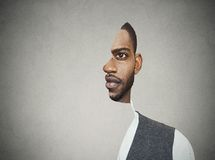 Surrealistic portrait front with cut out profile of a young man royalty free stock photos