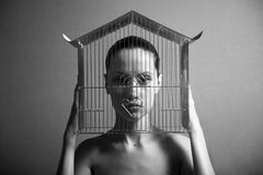 Surrealistic woman with cage. Surrealistic portrait of young woman with cage. Black and white photo Stock Photography