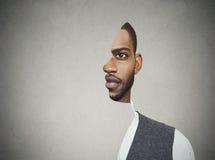 Surrealistische Porträtfront mit herausgeschnittenem Profil eines jungen Mannes Lizenzfreie Stockfotos