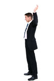 Surrender. Businessman holding up both hands in surrender Stock Image