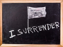 Surrender word on blackboard Royalty Free Stock Photography