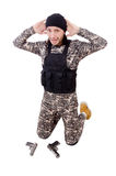 Surrendering man in military uniform holding Stock Photos