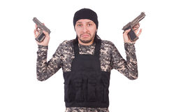 Surrendering man in military uniform holding gun Stock Photography
