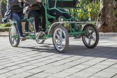 Surrey bike in motion at Plaza de Espana, Seville Royalty Free Stock Images