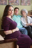 Surrogate Mother with Gay Couple. Confident surrogate mother with male homosexual parents Stock Photos